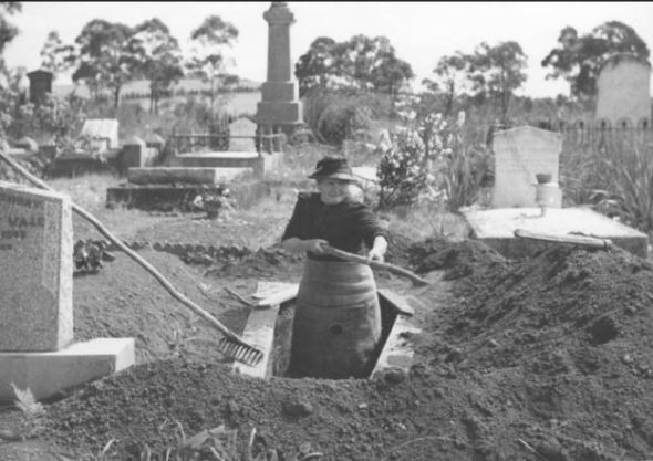 Josephine Smith, age 84, digging a grave at Drouin Cemetery, Victoria, c. 1944 https://www.flickr.com/photos/national_library_of_australia_commons/6174073756